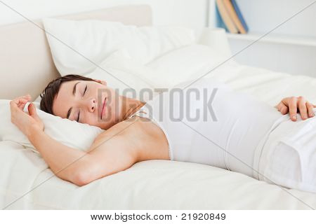 Beautiful woman having a nap in her bedroom