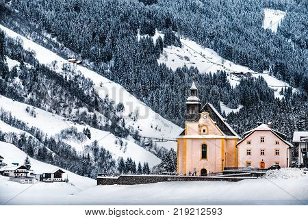 panoramic frost landscapes of Dolomite of alto adige - church under snow fall in ridanna valley ( Val Ridanna ) near Vipiteno - Racines - Italy