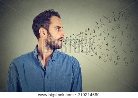 Man talking with alphabet letters coming out of his mouth. Communication information intelligence concept