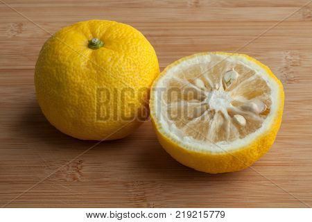 Fresh yellow whole and half Japanese Yuzu fruit