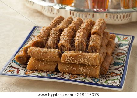 Traditional festive Moroccan cookies with sesame seeds and mint tea