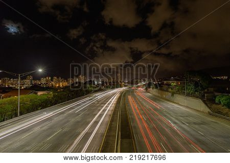 Night long exposure shot with light trails on busy highway Hawaii USA