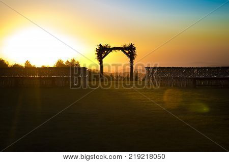 Outdoor sunset view of a Jewish traditions wedding ceremony. Wedding canopy chuppah or huppah
