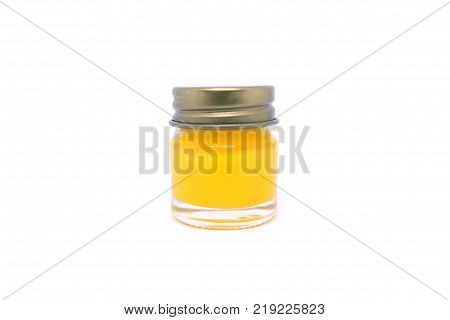 A glass bottle of mentholated ointment on white blackground.