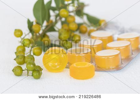 cough sore throat pastille colorful pills from herbal on background white