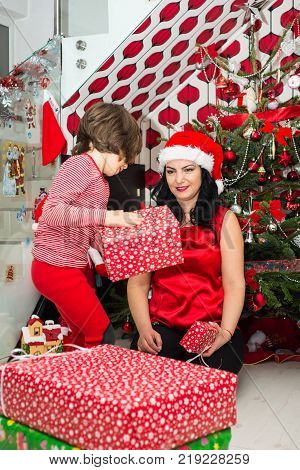 Mother And Son Prepare For Christmas And Wrapping Their Presents