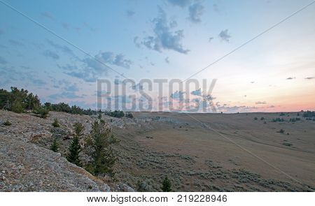 Blueish Orange Sunrise over Teacup Canyon / Bowl on Sykes Ridge in the Pryor Mountains on the Wyoming Montana state line - United States
