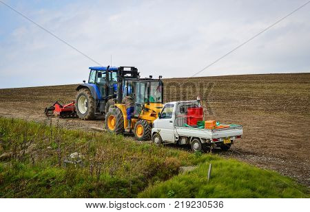 Hokkaido Japan - Oct 2 2017. Tractors working on the farm in Hokkaido Japan. Hokkaido is the second largest island of Japan and the northernmost prefecture.