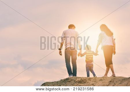 son father mother boy fun love nature vacation happiness young family joy summer sun together outdoors play travel smiling parents walk lifestyle relationship parent active photo happy family positive people relatives recreational activity sky relaxation