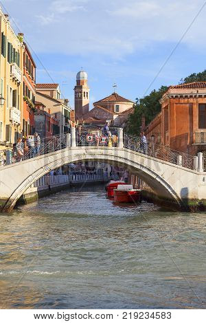 VENICE ITALY - SEPTEMBER 20 2017: Grand Canal bridge over side channel. Communication in the city is done by water which creates a network of 150 channels interconnected.