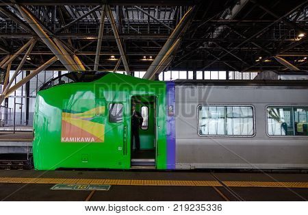 Hokkaido Japan - Oct 2 2017. A green train at Sapporo Station in Hokkaido Japan. Hokkaido is the second largest island of Japan and the northernmost prefecture.