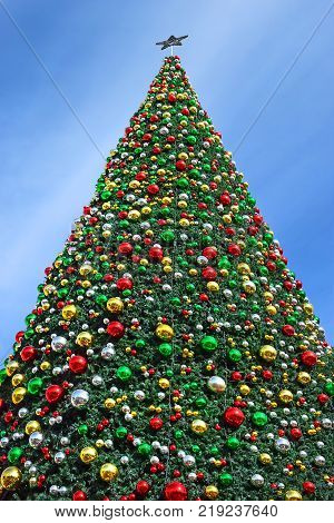 fragment of decorated christmas tree in Nazareth, Israel as a new year or christmas background