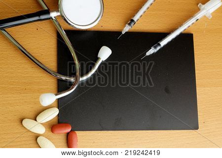 Healthcare concept with stethoscopemedicine and insulin syringe. Copy space
