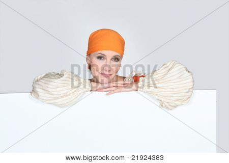 Woman in pantomine outfit with a blank board ready for message