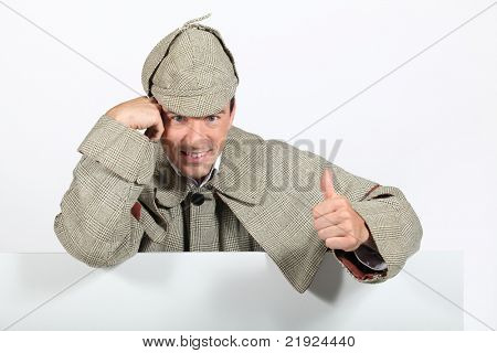 Man dressed as old fashioned detective