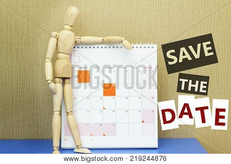 Concept of Save The Date with ball-jointed doll