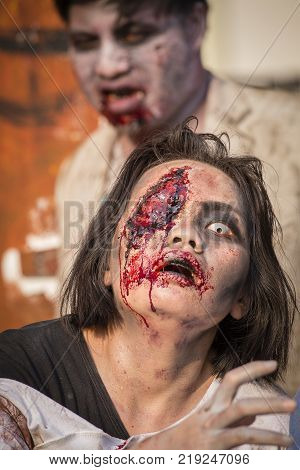 BANGKOKTHAILAND - FEBRUARY 08 2015 : Unknown Thai girl and guy participates in FOX Thai The Walking Dead Season 5 Marathon dressed as zombies