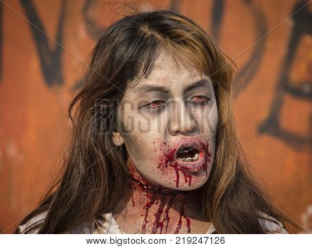 BANGKOKTHAILAND - FEBRUARY 08 2015 : Unknown Thai girl participates in FOX Thai The Walking Dead Season 5 Marathon dressed as zombies