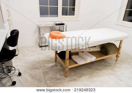 massage table with pillow in spa salon