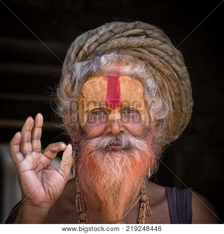 KATHMANDU NEPAL - SEPTEMBER 25 2016 : Portrait Sadhu at Pashupatinath Temple in Nepal. Sadhu is a holy man who have chosen to live an ascetic life and focus on the spiritual practice of Hinduism.