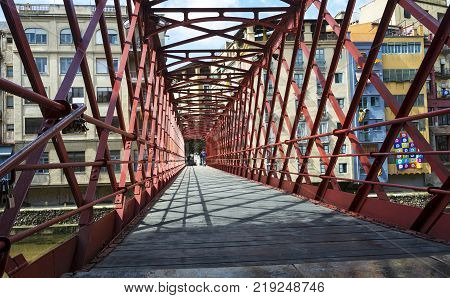 Spain, Gerona - 18/09/2017: The pedestrian bridge of the French engineer Eiffel built in the Spanish city of Girona across the river Onyar