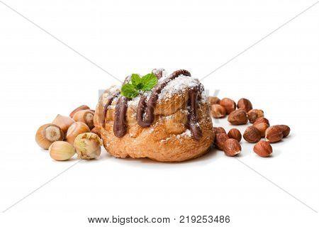 Belgian chocolate choux buns stuffed whith hazelnut cream isolated on white