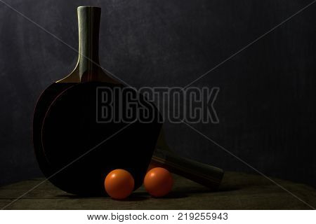 Ping pong racket on a round wooden table. Beautiful background.