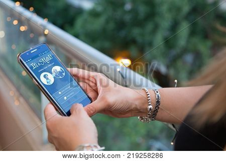 ROSARIO, ARGENTINA - DECEMBER 11, 2017: Woman with a smartphone in her hands with a tinder application on the screen. It´s a Match screen.  Young woman, millennial, Technology.