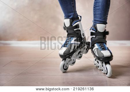Legs of young woman on roller skates indoors