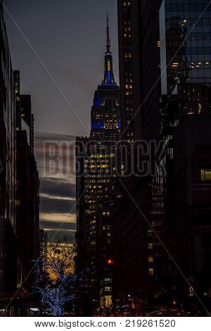 Manhattan, New York, December 20, 2017:buildings and Empire State Building and dark evening sky