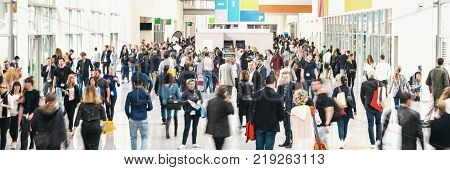 business people crowd at a tradeshow banner size. ideal for websites and magazines layouts
