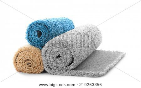 Rolled colorful carpet on white background