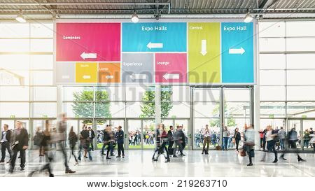 business people walking at a modern floor on a tradeshow with banner. ideal for websites and magazines layouts