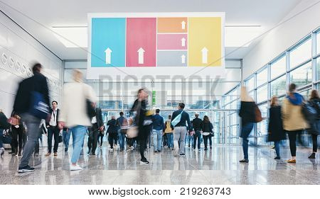 business people walking at a modern floor on a tradeshow. ideal for websites and magazines layouts