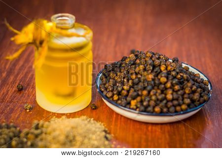 Black Pepper,piper Nigrum With Its Powder And Oil.