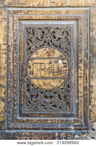 Round floral patterns carved into the exterior ancient stone wall of al Refai Mosque Old Cairo Egypt