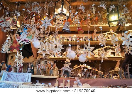 Cologne, Germany - December 16, 2017: Beautiful handmade wood Christmas ornaments. A vendor sells handmade traditional wood crafts, Christmas decorations and ornaments at the Cologne Cathedral Christmas market.