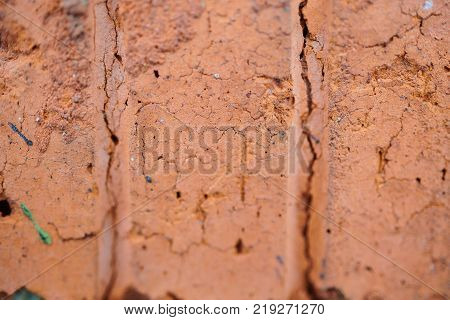 The texture of old red bricks with fissures and fractures, background