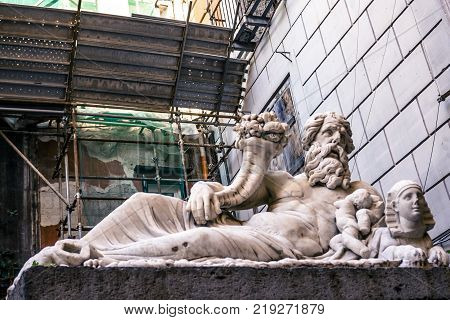 The statue of the god Nile is a marble sculpture from the Roman period, dated between the 2nd and 3rd century AD, in the heart of the historic city center of Naples