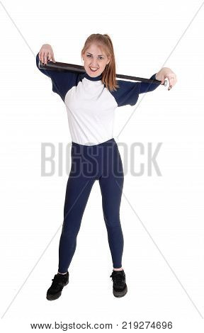 A young slim woman playing softball holding her bad and smiling in a blue uniform isolated for white background