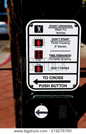 Traffic light button.Use traffic lights at the crossroads. Button of the mechanism lights traffic lights on the street. System control traffic light intersection close.