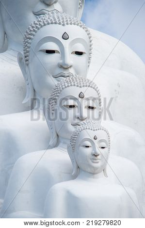 Phetchabun Province Thailand - September 3 2017: Face of White Buddha statues sit at Wat Pha Sorn Kaew Temple or Wat Phra Thart Pha Kaew Temple in Khao Kho Thailand. The Temple is set on an 830m peak.