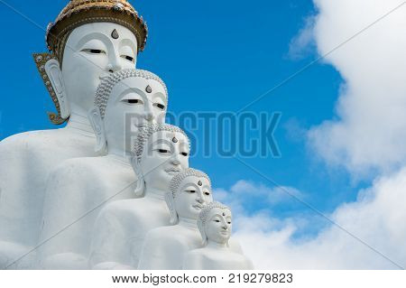 Phetchabun Province Thailand - September 3 2017: Face of Five White Buddha statues sit at Wat Pha Sorn Kaew Temple or Wat Phra Thart Pha Kaew Temple in Khao Kho Thailand. The Temple is set on an 830m peak.