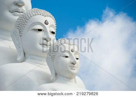Face of White Buddha statues sit at Wat Pha Sorn Kaew Temple or Wat Phra Thart Pha Kaew Temple in Khao Kho Thailand.