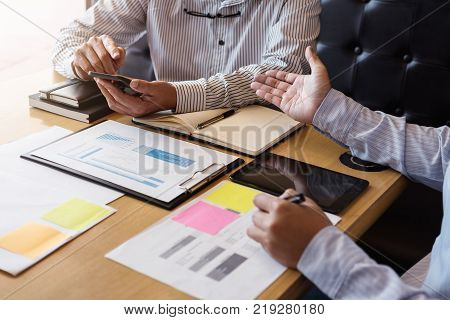 Two Business man or accountant working Financial investment writing report Analyze business and market growth and calculating cost on financial document data graph Accounting Economic commercial.