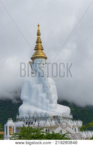 Phetchabun Province Thailand - September 3 2017: Five White Buddha statues sitting at Wat Pha Sorn Kaew Temple or Wat Phra Thart Pha Kaew Temple in Khao Kho Phetchabun Province Thailand. The Temple is set on an 830m peak.