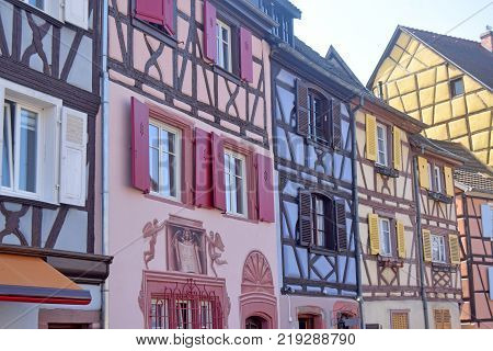 20 November 2017 - Strasbourg-Alsace-France-A typical medieval street with the multicolored facades of the historic half-timbered houses and the walls embellished with frescoes that make them unique and unmistakable