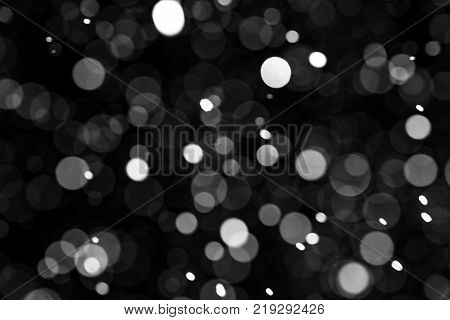 Natural texture of falling snow against the background of the night sky