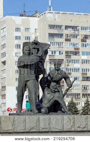 Nizhny Novgorod, Russia. - March 14.2017. The sculptural group is a worker, a soldier and a collective farmer near the pedestal with Vladimir Ilyich Lenin at the top