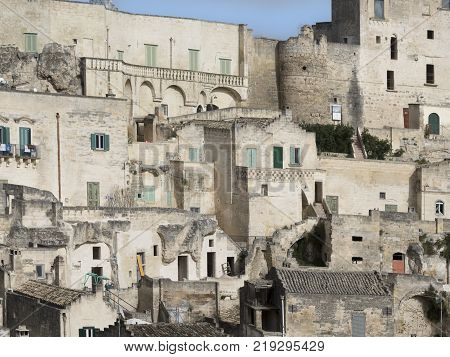 Ancient architecture of Sicilian city of Matera with the dense houses. Panoramic view of the borough, houses, windows, arches, terraces